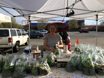 Mimi at market with spinach
